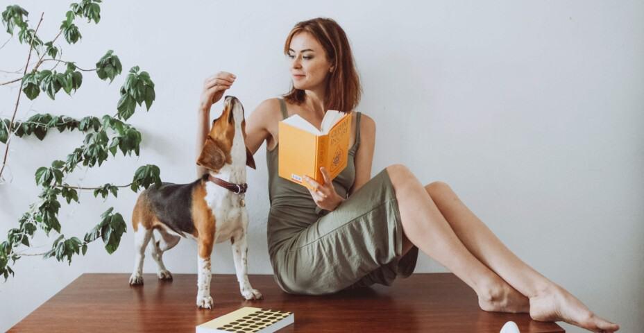 Woman feeding dog treat